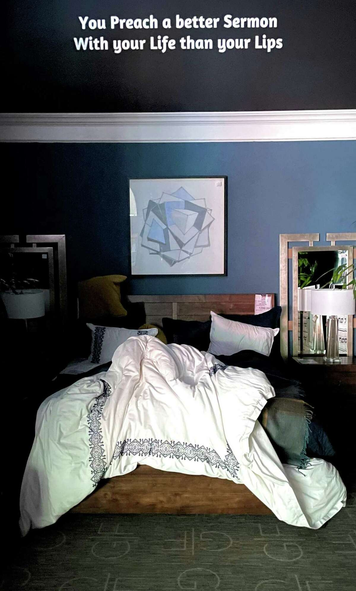 A person sleeps in one of Gallery Furniture's beds during the storm on Wednesday, Feb. 17, 2021.