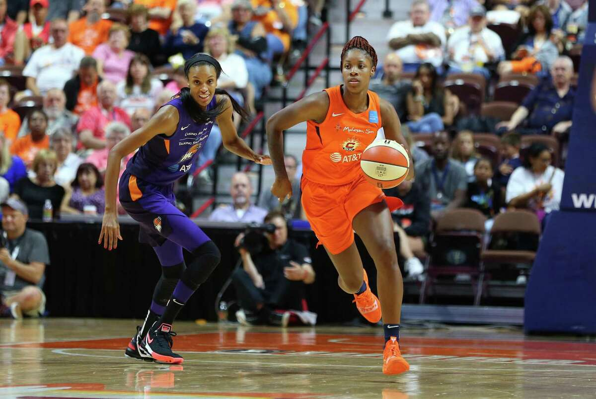 Connecticut Sun guard Bria Holmes (32) and Phoenix Mercury forward DeWanna Bonner (24) in action during a WNBA game in 2019.