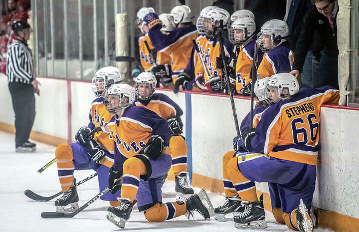 """Members of the Bethalto hockey team take a break during a playoff game against Alton. The teams will face off Monday in the first game of the Mississippi Valley Club Hockey Association's spring """"tournament"""" at the East Alton Ice Arena."""