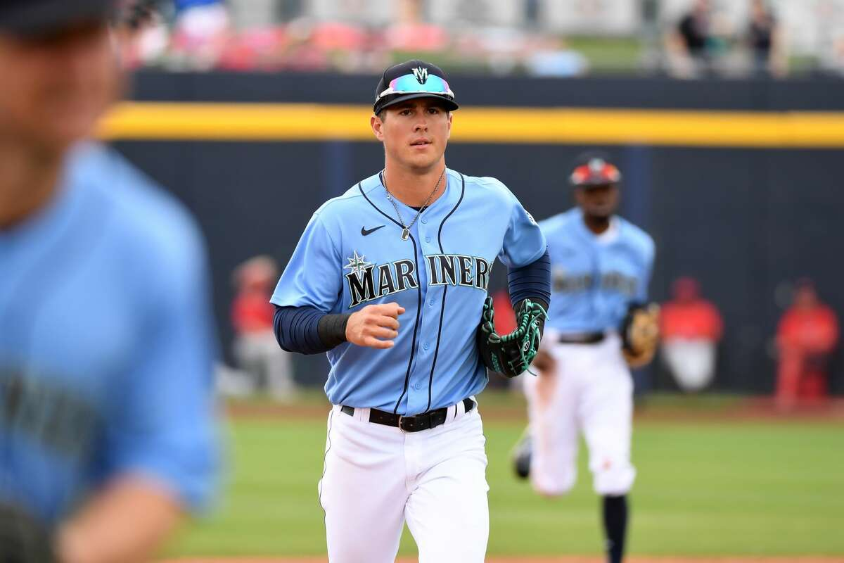 PEORIA, ARIZONA - MARCH 10: Dylan Moore #25 of the Seattle Mariners runs to the dugout after the end of an inning against the Los Angeles Angels during a spring training game at Peoria Stadium on March 10, 2020 in Peoria, Arizona. (Photo by Norm Hall/Getty Images)