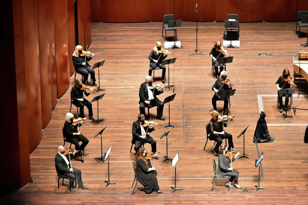 When the symphony performed, musicians were spread out on the stage, and rather than sharing music stands, each musician had their own. The string players were masked the entire time.