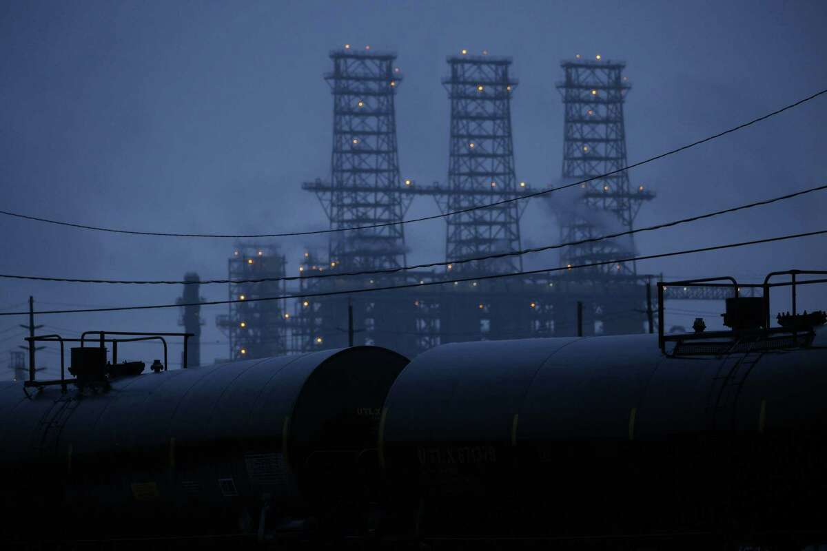 Rail tank cars sit near the Motiva Enterprises Refinery in Port Arthur. The winter storm disrupted refinery operations.