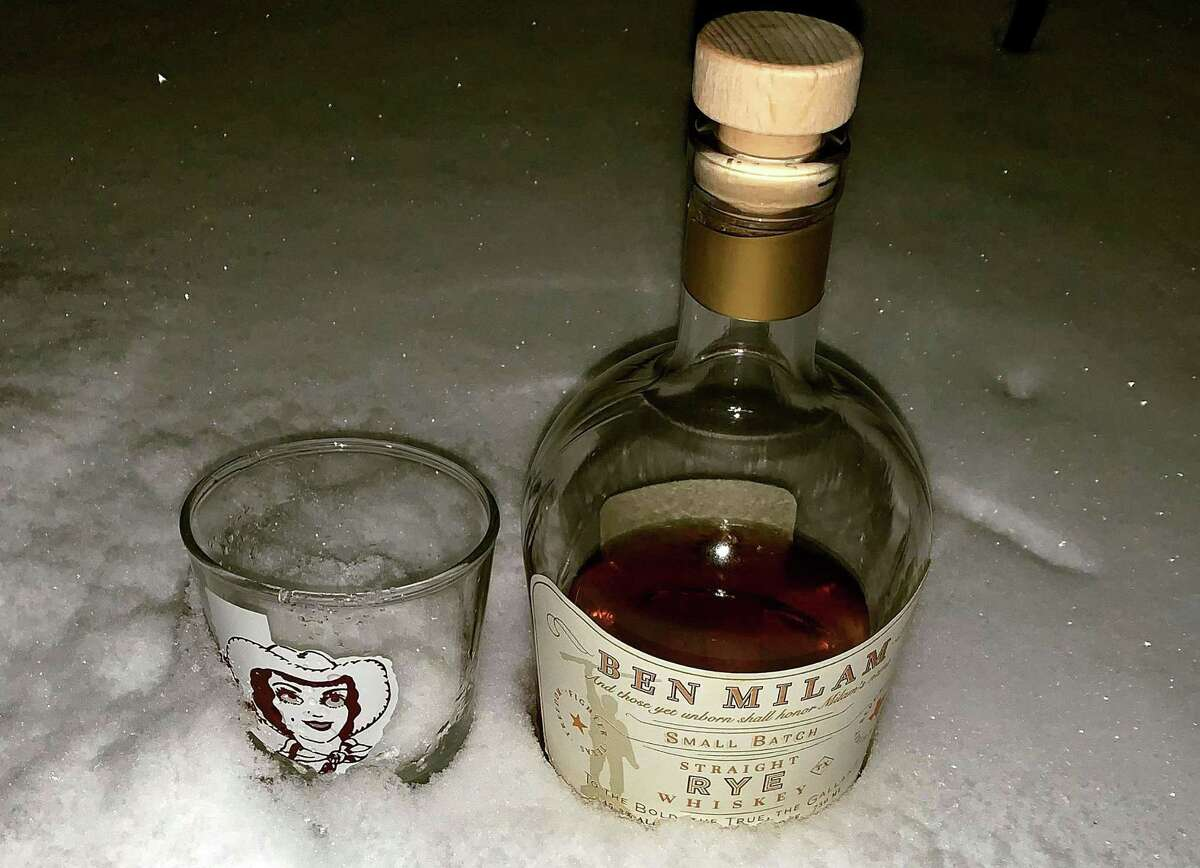 """""""instead of highballs, we're having snowballs!"""" read the Facebook post from San Antonio graphic artist Christine Sykes that accompanied this photo. Several San Antonians used the snow as a chiller for booze."""