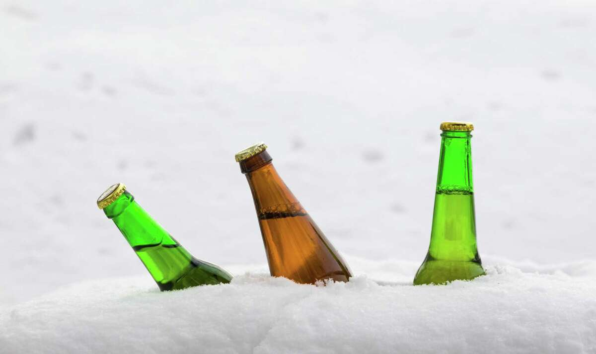 Beer and wine bottles poking out of snow were a common sight during the recent snowfall in San Antonio.