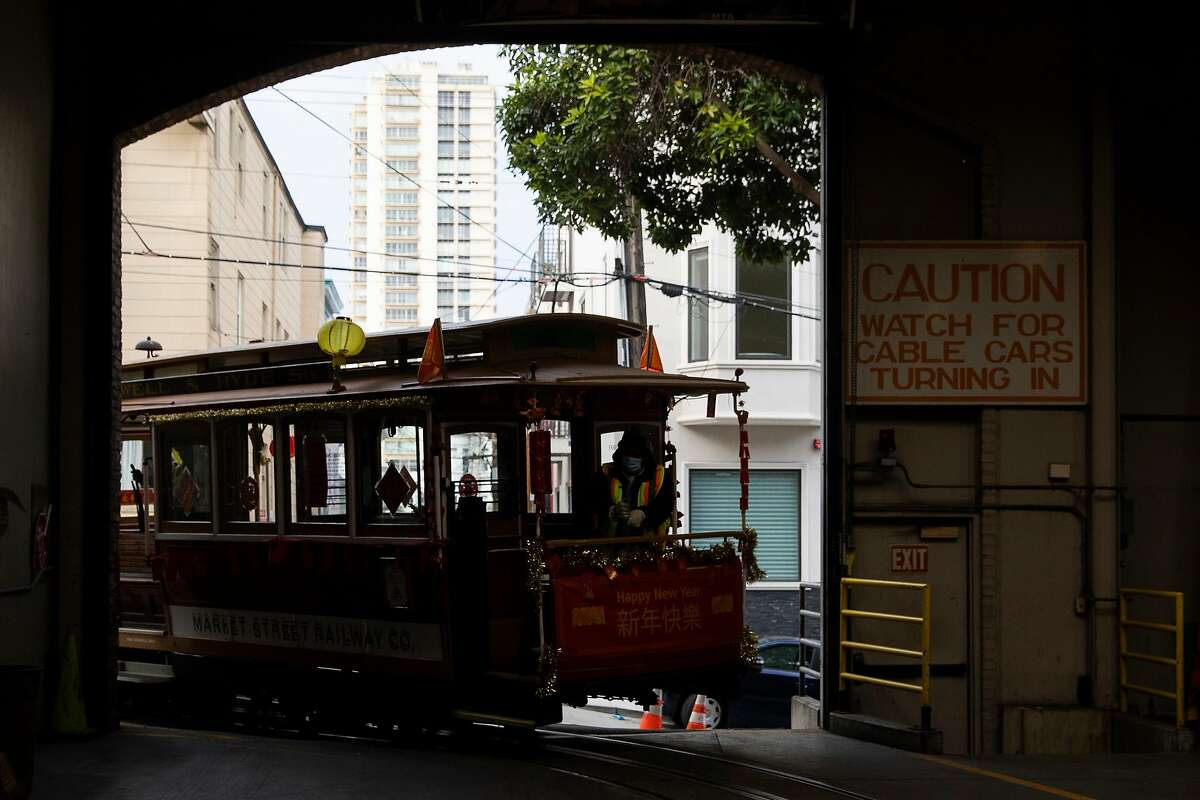 A cable car is steered into the San Francisco Cable Car Barn in the Nob Hill neighborhood of San Francisco, Calif. Thursday, February 18, 2021. SFMTA says they are unsure if cable cars will be put back into service following the COVID-19 pandemic due to budget constraints.