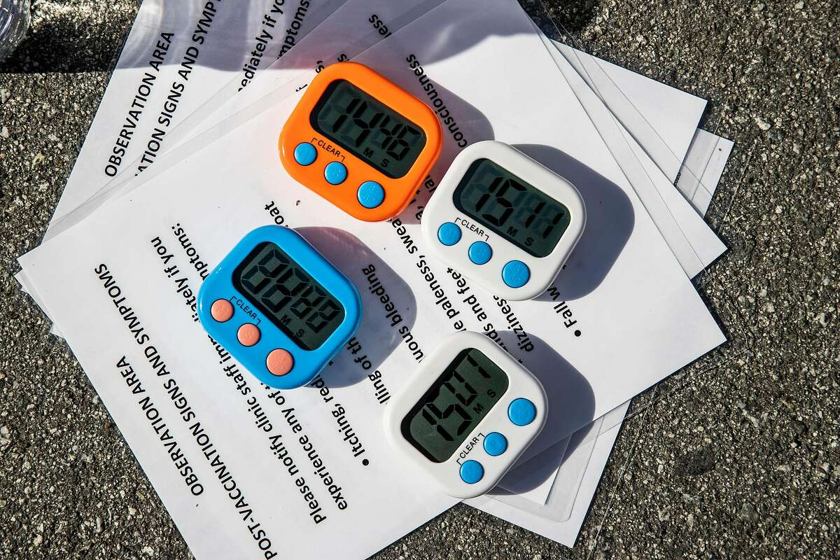 Timers are used to track each vaccinated person during a pop-up vaccination clinic at the Gilroy Senior Center.