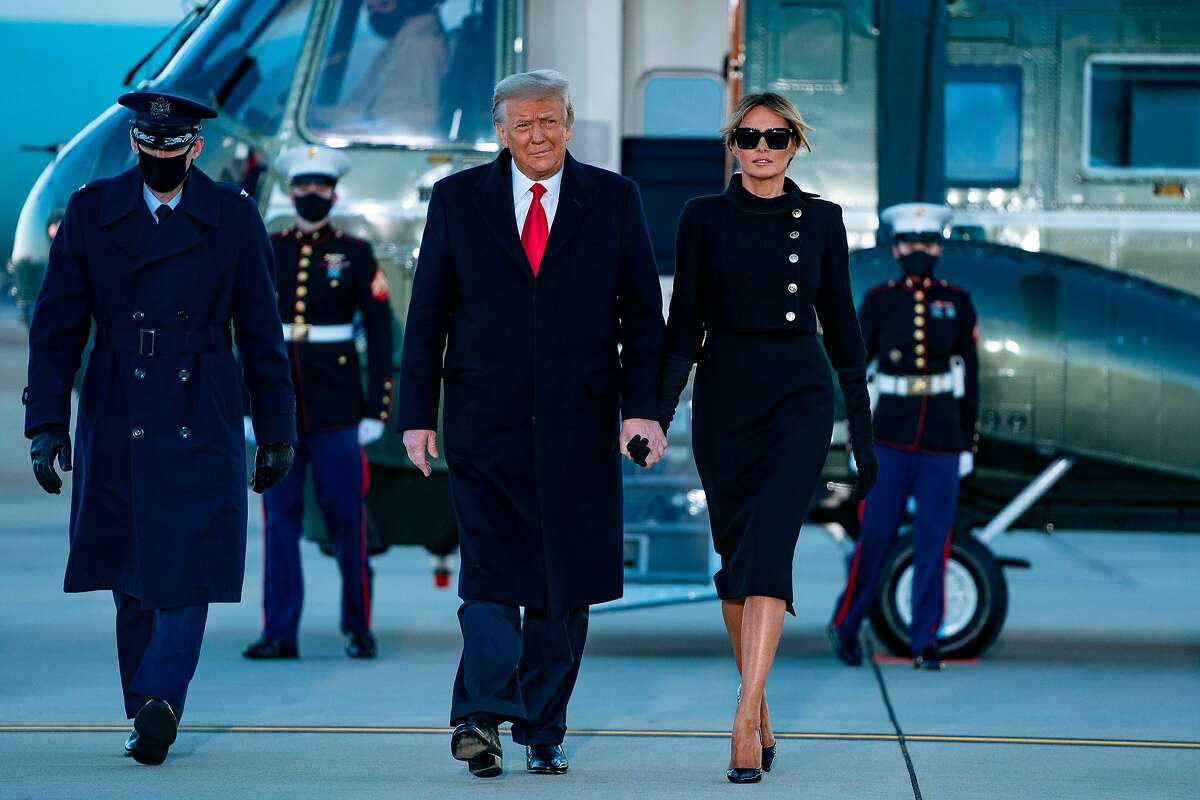 Outgoing President Donald Trump and first lady Melania Trump step out of Marine One at Joint Base Andrews in Maryland on Jan. 20.