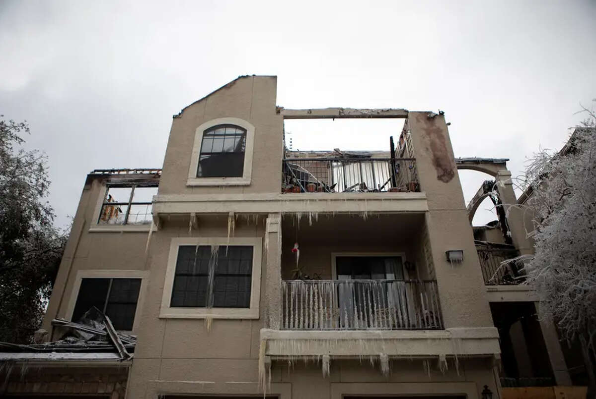 Fire damaged an apartment building in Austin this week. The freezing temperatures and icy snow that knocked out power for millions of Texans has spawned a new set of worries, including the cost of repairs. Credit: