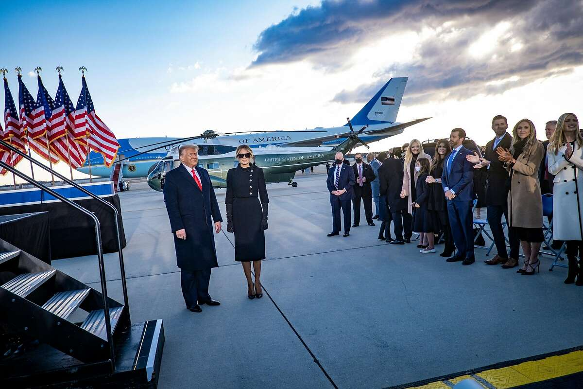 """A Nixon-era standard of the """"outer perimeter"""" of authority may apply to President Donald Trump, shown preparing to board Air Force One with first lady Melania Trump on Jan. 20."""