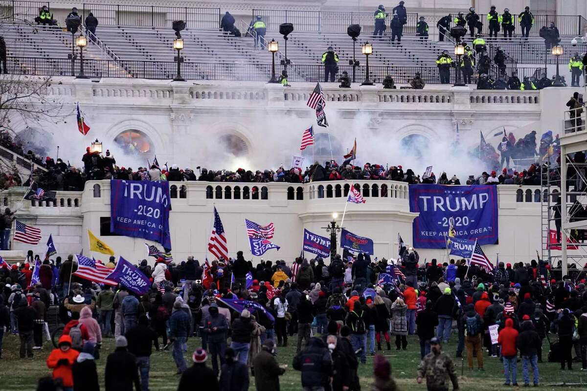 Violent protesters storm the Capitol, in Washington, on Jan. 6.