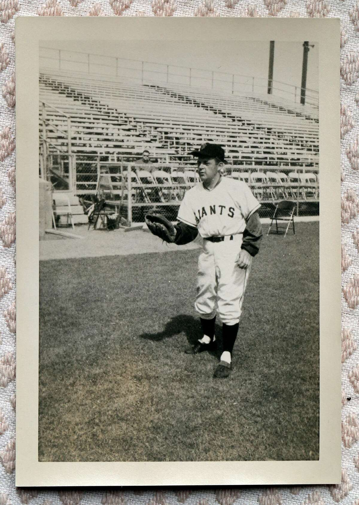 Bob Lurie in a 1958 photo dressed in a Giants uniform at his home in Atherton, Calif., on Sunday, February 14, 2021. In 1981, Bob Lurie hired Frank Robinson, the first Black manager in the National League.