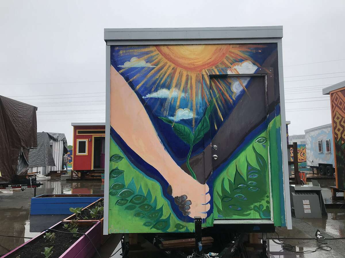The 8-by-10-foot homes have electricity and heated floors. Each has a bed that can fold into the wall and become a desk. Williams-Sonoma donated rugs and sheets, and artists painted murals on the tiny homes.