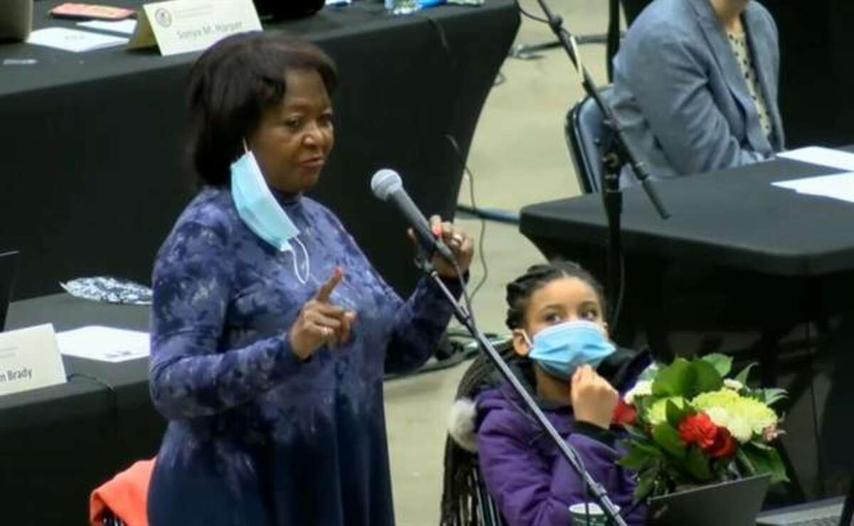 Rep. Mary Flowers, accompanied on the floor of the Bank of Springfield Center by her granddaughter at the beginning of the 102nd General Assembly in January, is the longest-serving Black lawmaker in the history of the Illinois General Assembly.