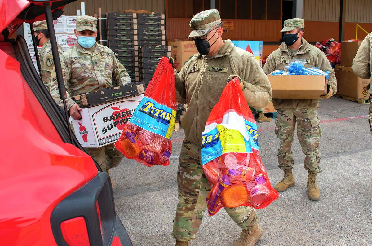 Members of the Texas National Guard help the South Texas Food Bank distribute food to Laredoans affected by the extreme cold and power outages, Thursday, Feb. 18, 2021 at the STFB facility.