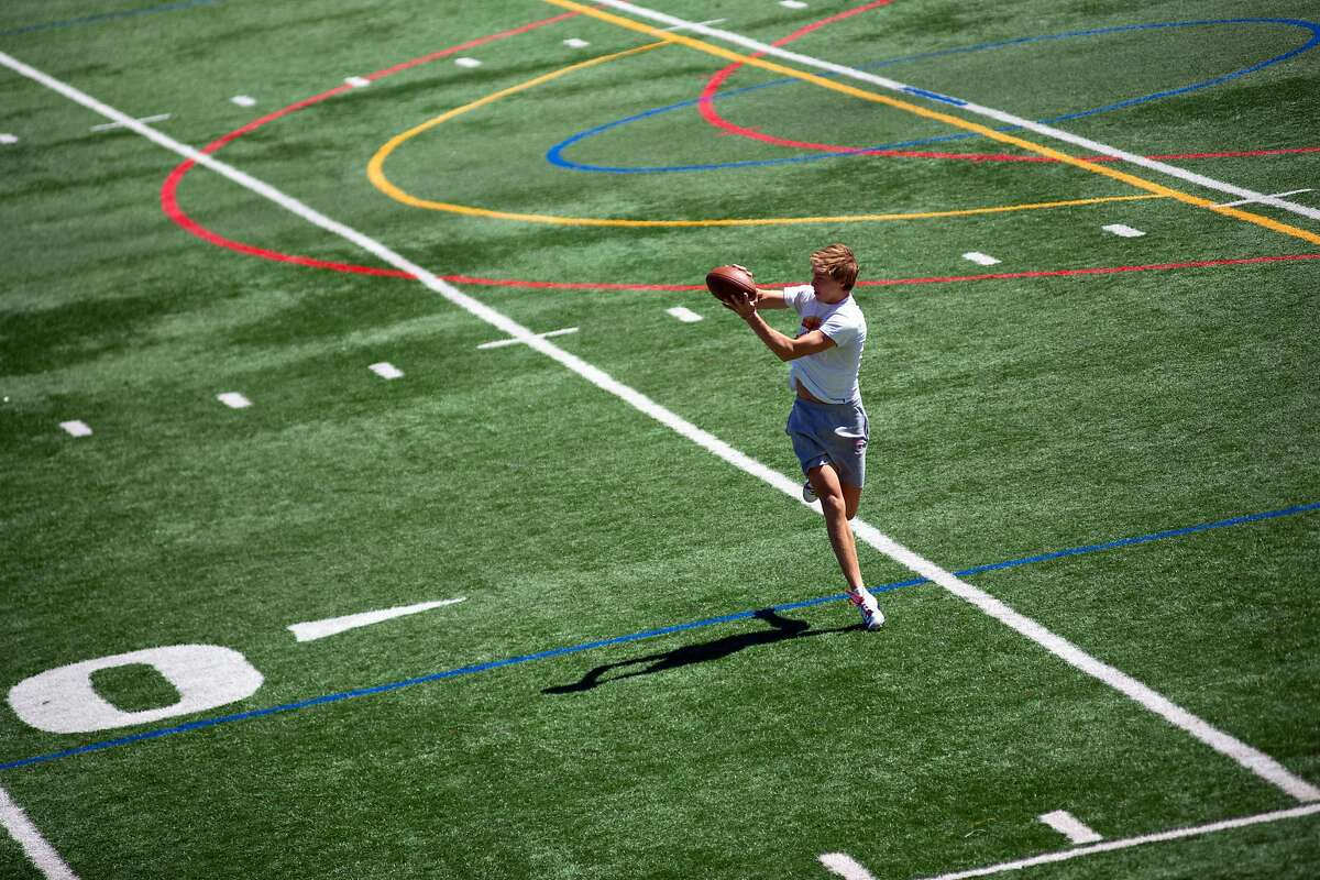 Charlie Craig, Campolindo High senior, 17 years old, catches a football during a Lamorinda Bomb Squad practice at Campolindo High in Moraga.
