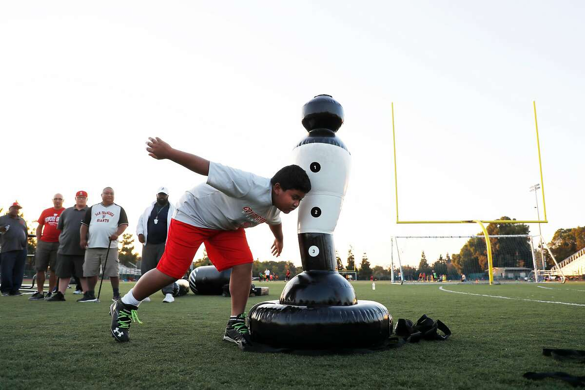 Tackling drills like this one in San Jose will return to California fields due to health guidelines updated Friday by the state.