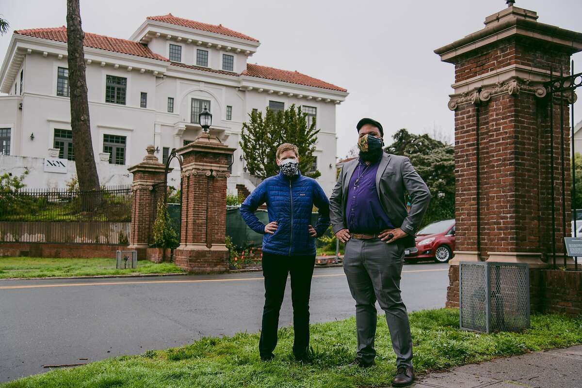 City Council members Lori Droste and Terry Taplin at the entrance of a gated neighborhood in Berkeley where residence was once restricted through racial covenants.