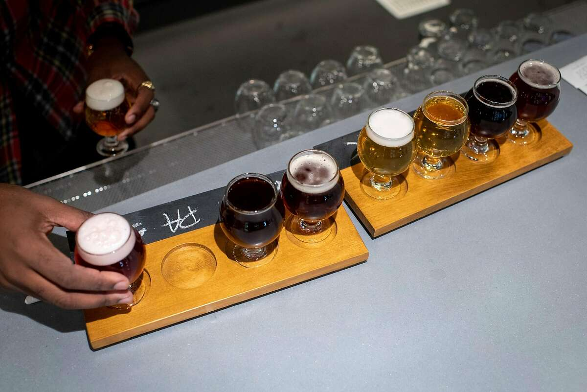 Bartender Ryan Edwards serves beer flights at Buck Wild Brewing, where all the beers are gluten-free.