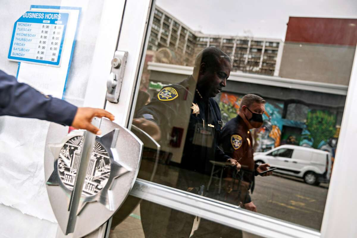 Oakland police Chief LeRonne Armstrong enters police headquarters after an interview with media on Tuesday, Feb. 9, 2021, in Oakland, Calif. His department is investigating five separate shootings that occurred May 7-8, 2021.