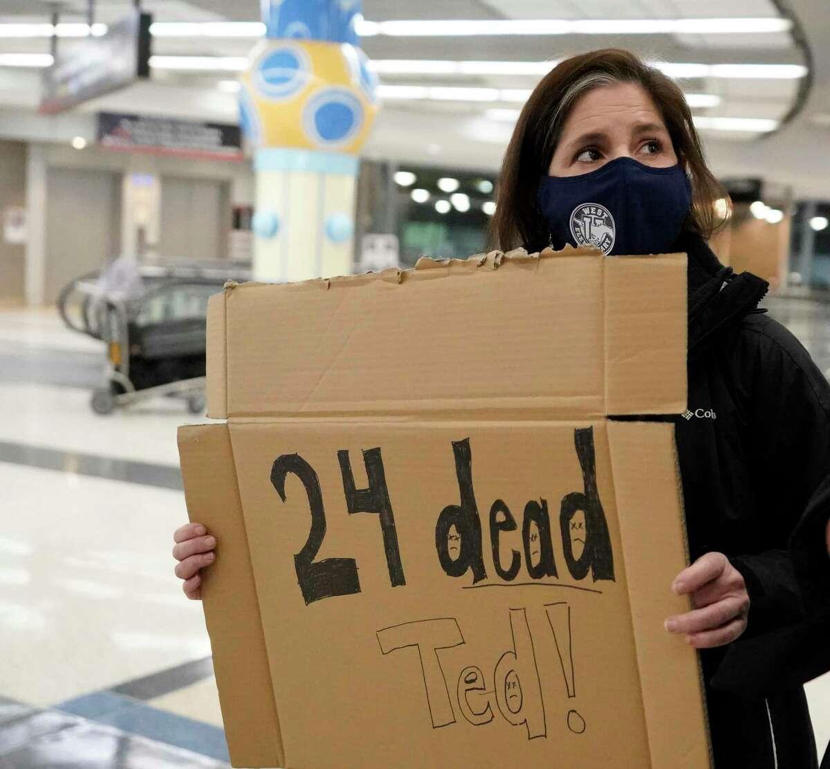 Mary Kay Hoffman waits for the return Thursday of Sen. Ted Cruz, R-Texas, at George Bush Intercontinental.