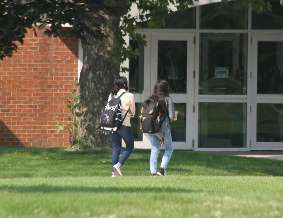 A pair of West Shore Community College students walk on campus. The use of Open Educational Resources at the college has helped make learning more affordable and better-suited to students' needs. Photo: File Photo