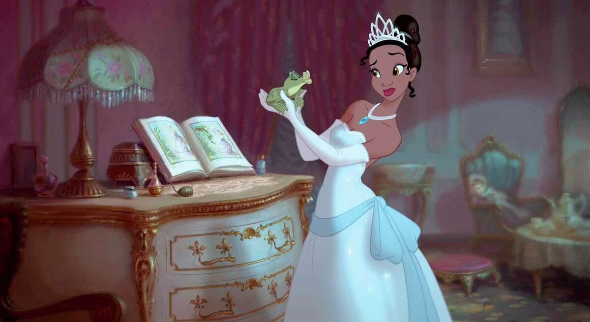 In this film publicity image released by Disney, Princess Tiana, voiced by Anika Noni Rose, holds Prince Naveen, voiced by Bruno Campos, in a scene from the animated film,