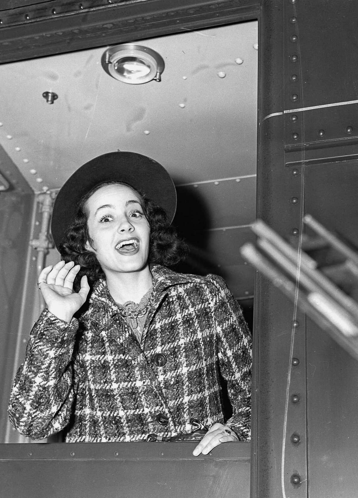 Bridgeport native Adriana Caselotti, who as a convent-educated teenager in 1934 won the role as the voice of sweet, innocent Snow White in Walt Disney's first feature-length cartoon, is shown arriving in New York on December 14, 1939.