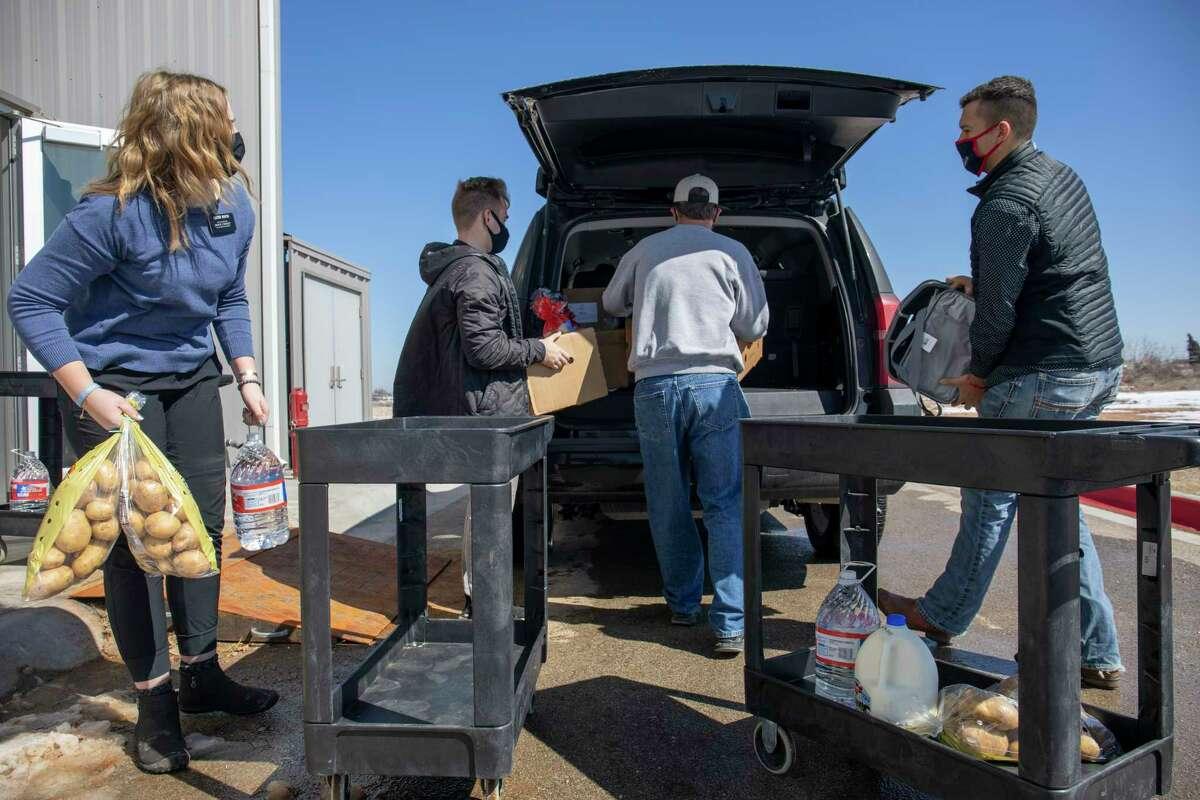 Volunteers help distribute food after the winter storm Friday, Feb. 19, 2021 at West Texas Food Bank. Jacy Lewis/ Reporter-Telegram