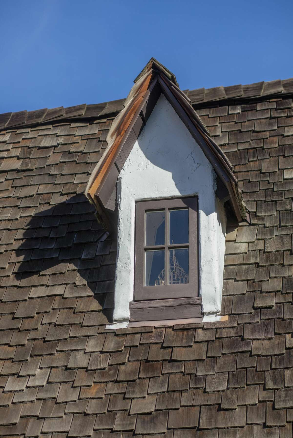 The wavy roofline and this dormer are a hallmark of the style.