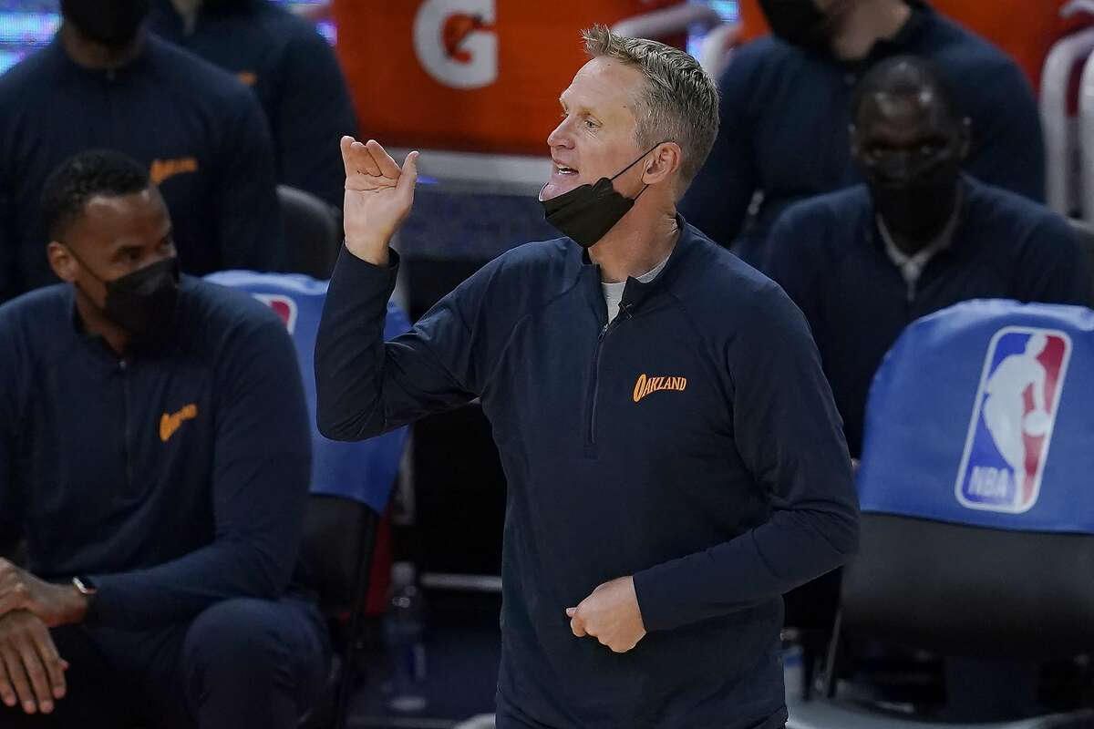 Golden State Warriors coach Steve Kerr gestures during the second half of the team's NBA basketball game against the Miami Heat in San Francisco, Wednesday, Feb. 17, 2021. (AP Photo/Jeff Chiu)