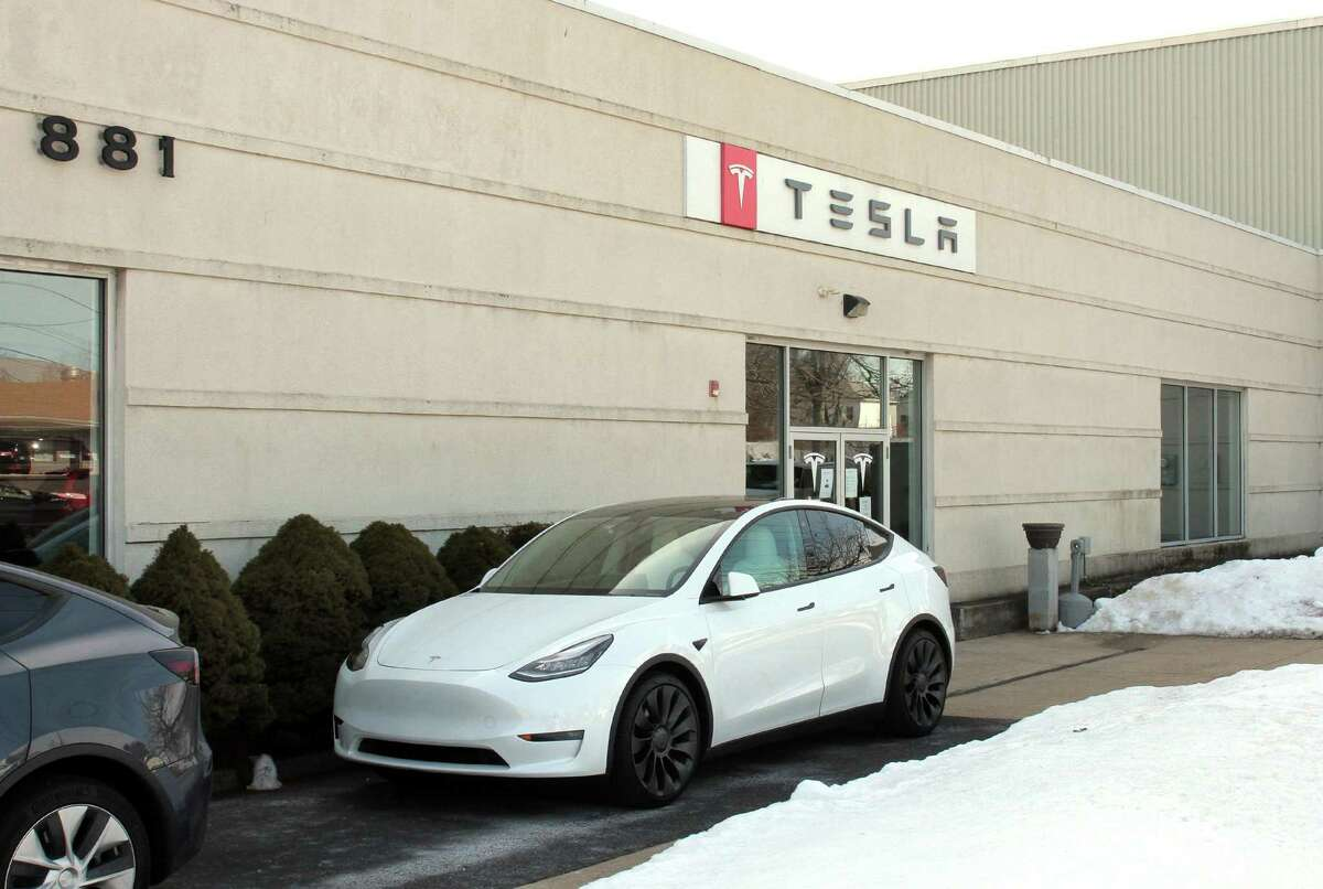 Tesla has a gallery and service center on Boston Post Road in Milford, Conn. Connecticut is looking to expand access to electric vehicles such as Tesla models by improving its EV subsidies program.