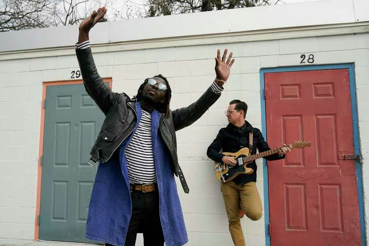"""Eric Burton, left, and Adrian Quesada of Black Pumas pose for a portrait in Austin, Texas on Feb. 5, 2021. Their deluxe debut album is nominated for album of the year at the 2021 Grammy Awards and their single """"Colors"""" is nominated for record of the year and best American roots performance. (AP Photo/Eric Gay)"""