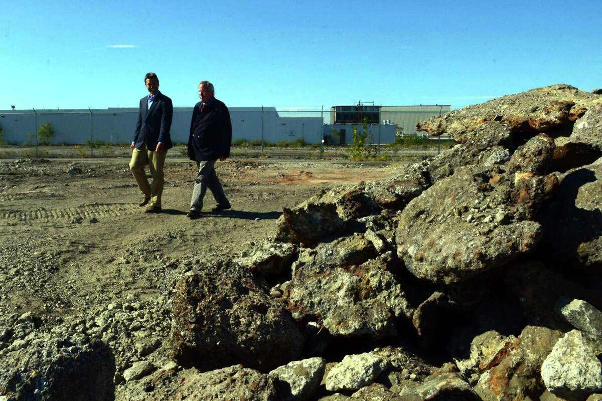 Bridgeport & Port Jefferson Steamboat Company Operations Manager Justin Ballotte, left, and Vice President and General Manager Fred Hall tour the future site of the company's ferry boat terminal off of Seaview Avenue in Bridgeport, Conn. on Thursday Sept. 28, 2017.