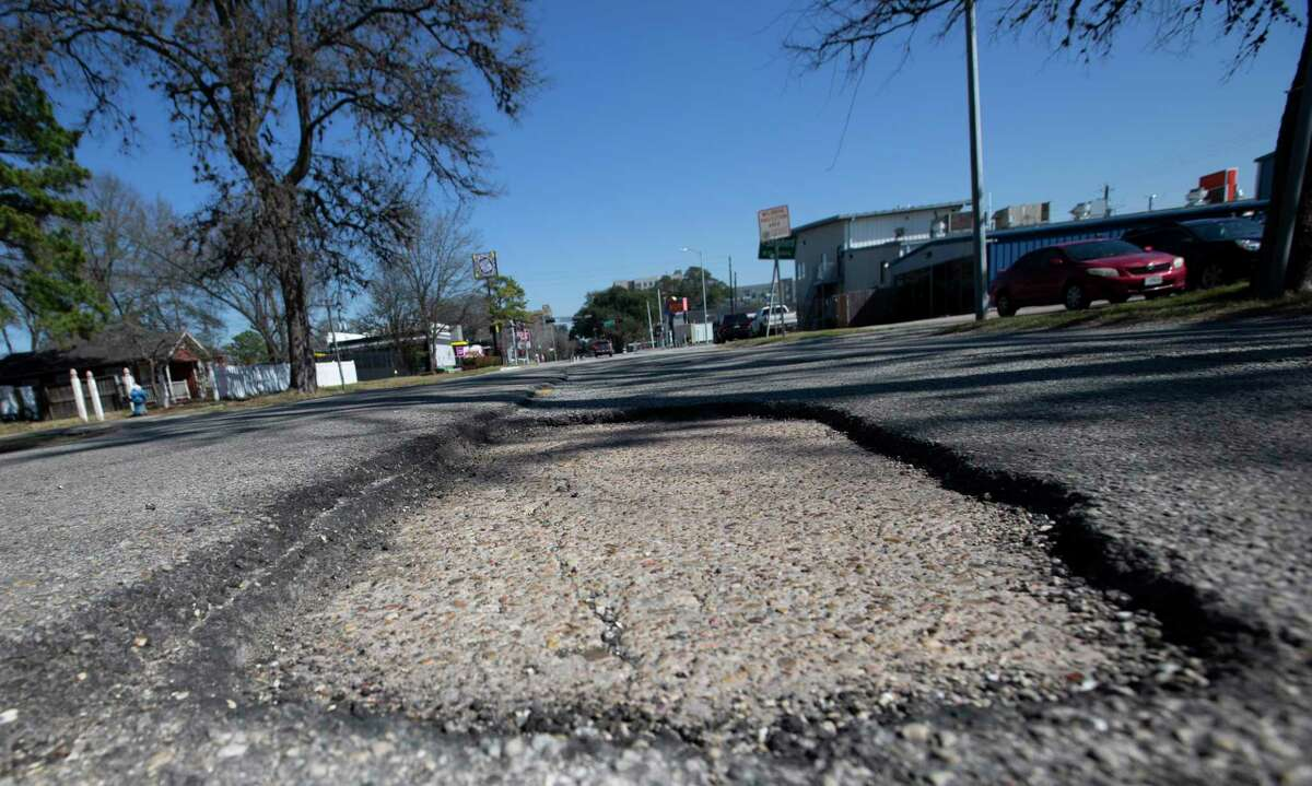 A pothole lies along 20th Street between Durham and Shepherd Drives, seen Feb. 19, 2021, near the Heights in Houston.