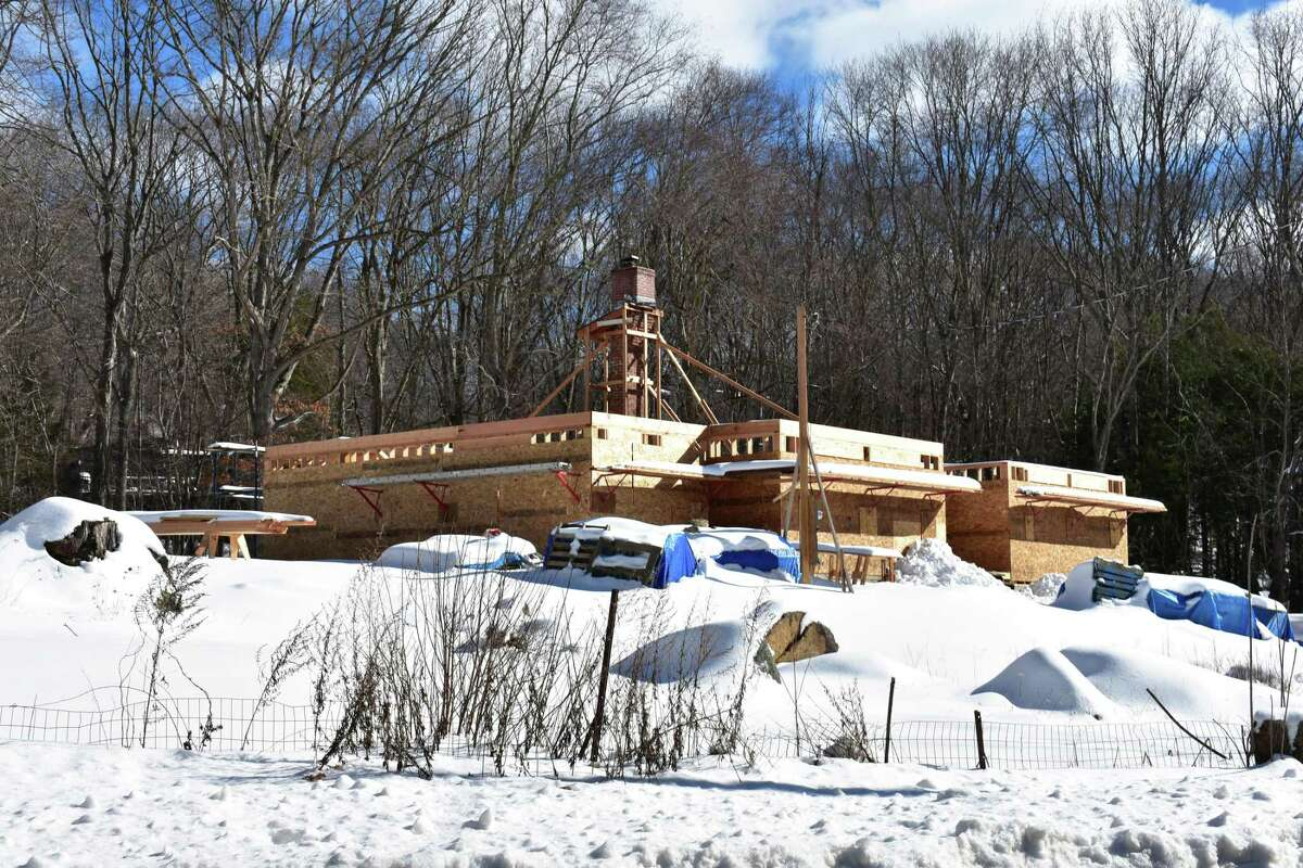 A new home takes shape in early February 2021 in Weston, Conn. During the pandemic year of 2020, permit applications for new houses outpaced those for new apartment units in Connecticut, reversing a sizable gap from 2019.