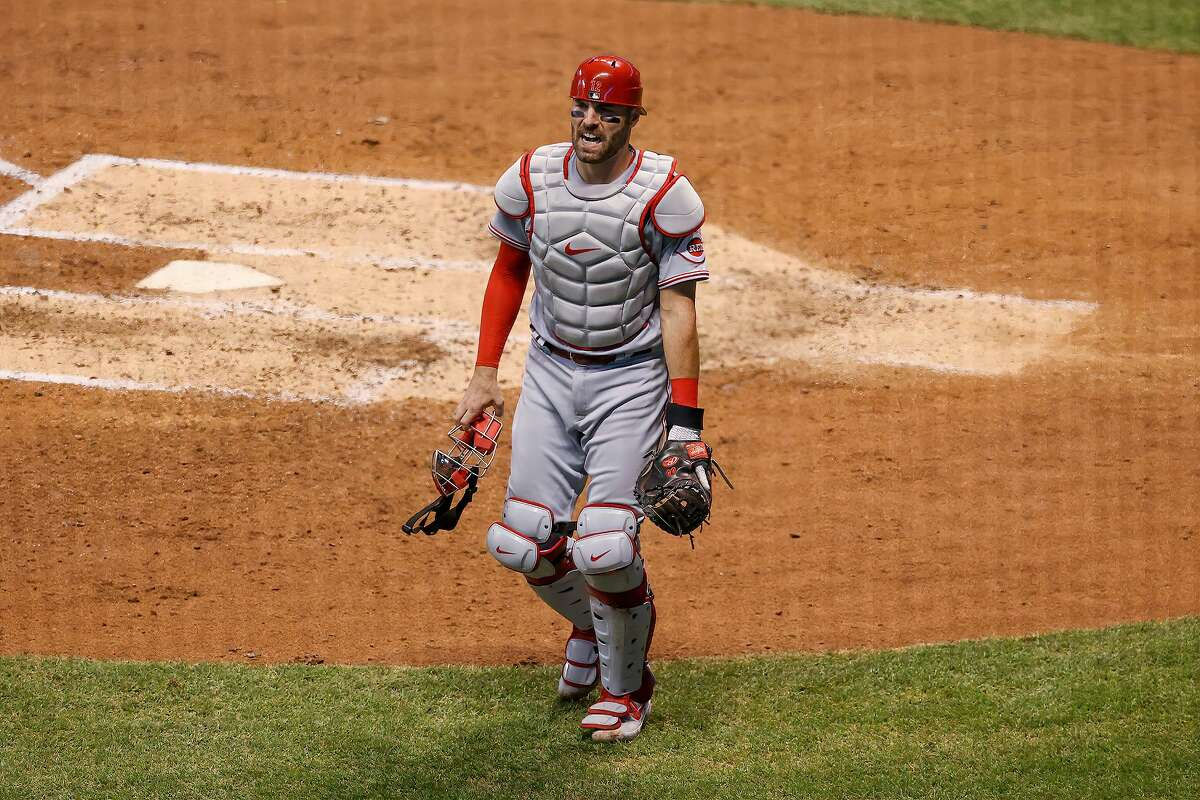 Curt Casali of the Reds reacts after getting hit by a foul ball last season.