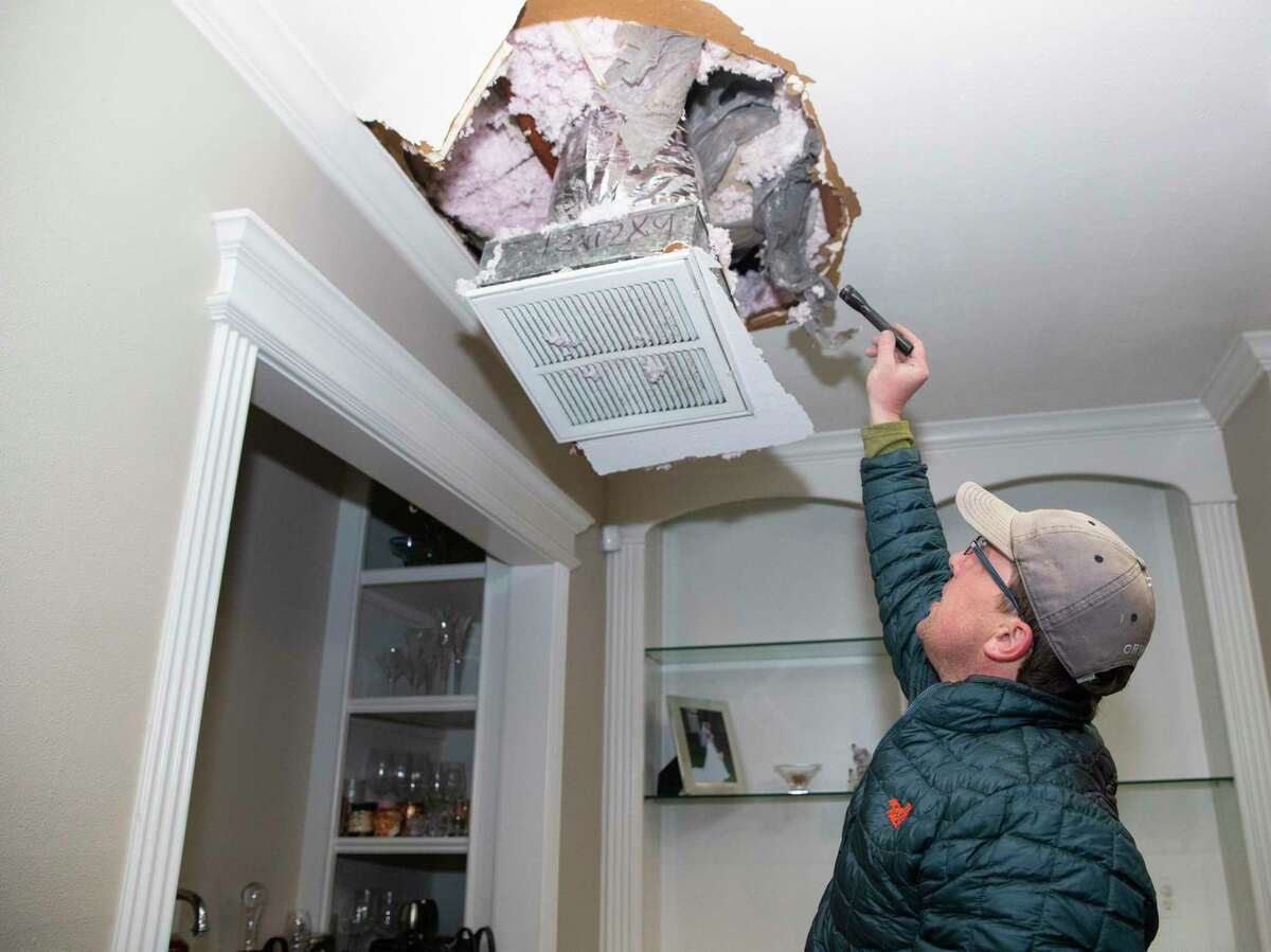 The sheetrock underneath a bust pipe in Nick Conway's attic comes down due to the leak Wednesday, Feb. 17, 2021, in Houston. Conway called his plumber but was told he was the 10th person on the line so he purchased a repair tape to fix the pipe himself.