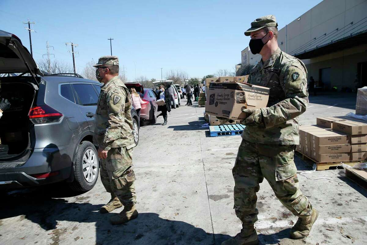 Soldiers with the Texas National Guard 36th Infantry Division help with food distribution at the San Antonio Food Bank, Friday, Feb. 19, 2021.