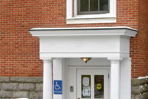 The town of Ridgefield has been improving accessibility in its public facilities. Including ramps and automatic door at Town Hall. An automatic door at Bailey Avenue entrance.Friday, February 19, 2021, in Ridgefield, Conn.