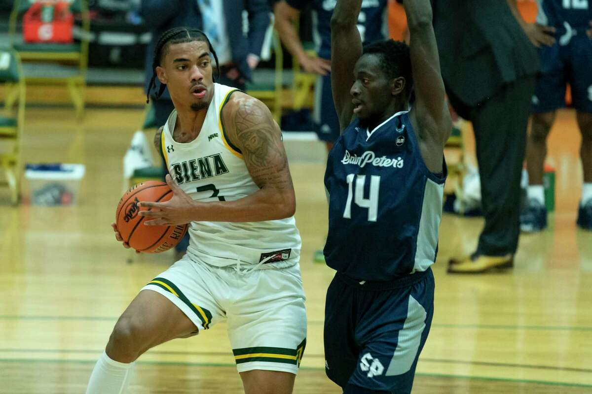 Siena's Manny Camper, left, was voted to the first team for the Senior CLASS Award on Friday.