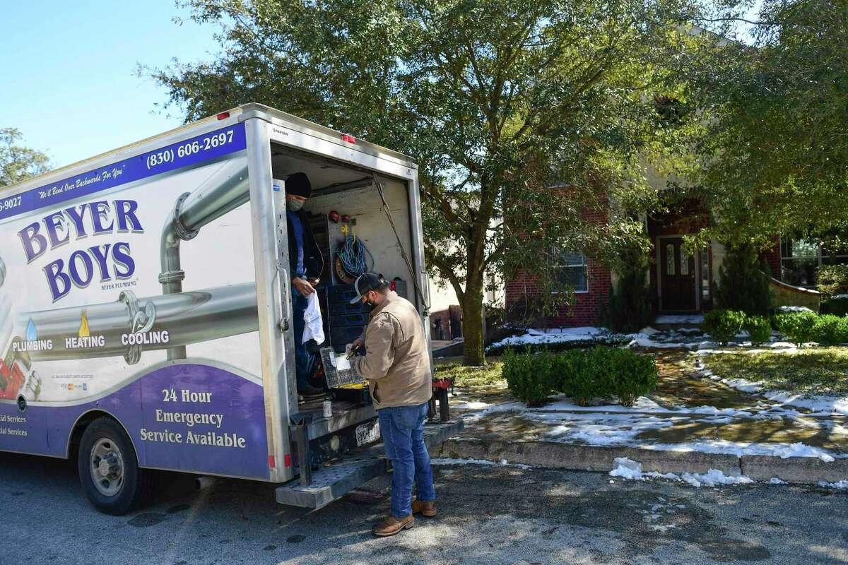 Harrison Quiel, in truck, and Alex Ortega of Beyer Plumbing prepare to make repairs.