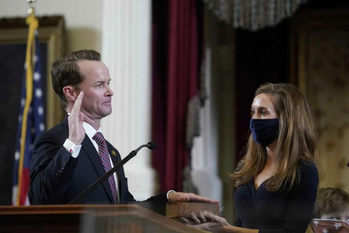 Dade Phelan is sworn in as Speaker of the Texas House. Legislators greet each other on the floor of the Texas House prior to the opening of the 87th Session of the Texas Legislature.