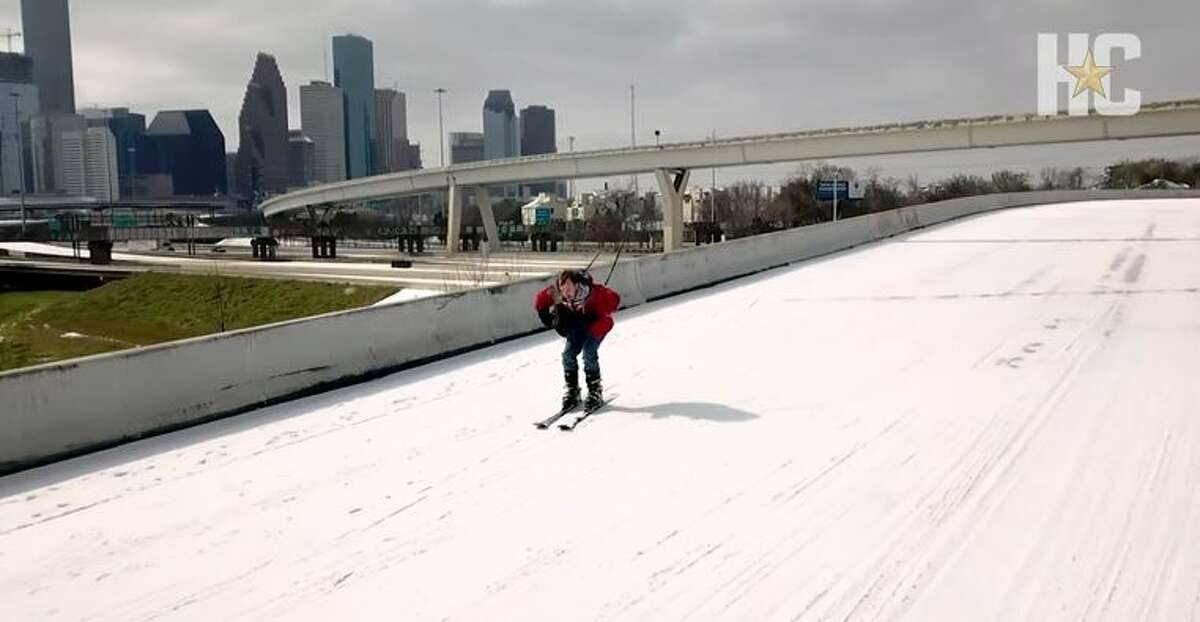 After a rare Houston snowfall, James Cody Hovland skied downtown's overpasses.