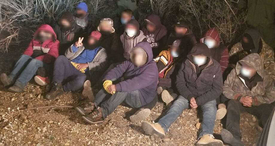 U.S. Border Patrol agents said they rescued this group of immigrants from 28-degree weather. Laredo West agents encountered the group in the brush. Photo: Courtesy Photo /U.S. Border Patrol
