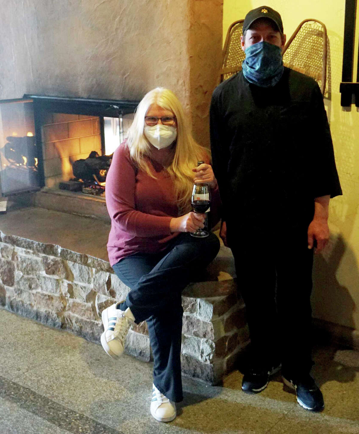 Connie Freiberg and chef Joel King, stand before the fireplace inside of the Blue Cow Cafe, Big Rapids' premier fine-dining restaurant.