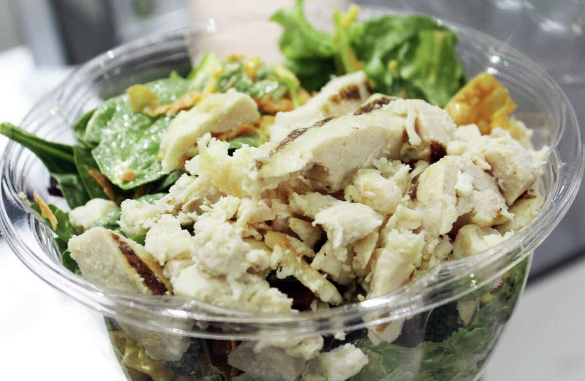 A fresh spinach and chicken SaladCraft salad made by Pokémoto Middletown owner Chi Hing Sze.