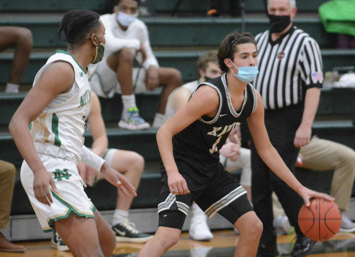 Xavier's Justin Menard dribbles the ball against Notre Dame-West Haven on Friday night.