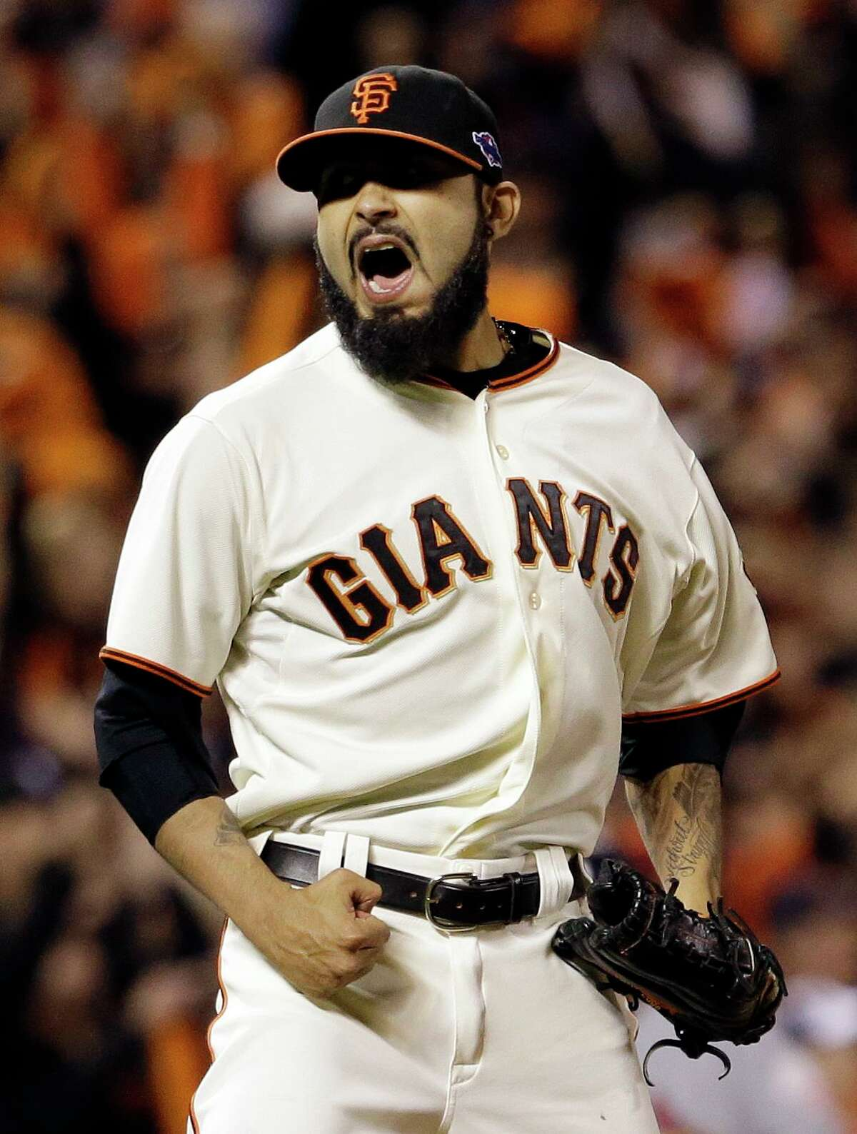 San Francisco Giants relief pitcher Sergio Romo reacts after the final out in the ninth inning of Game 6 of baseball's National League championship series against the St. Louis Cardinals Sunday, Oct. 21, 2012, in San Francisco. The Giants won 6-1 to tie the series at 3-3. (AP Photo/David J. Phillip)