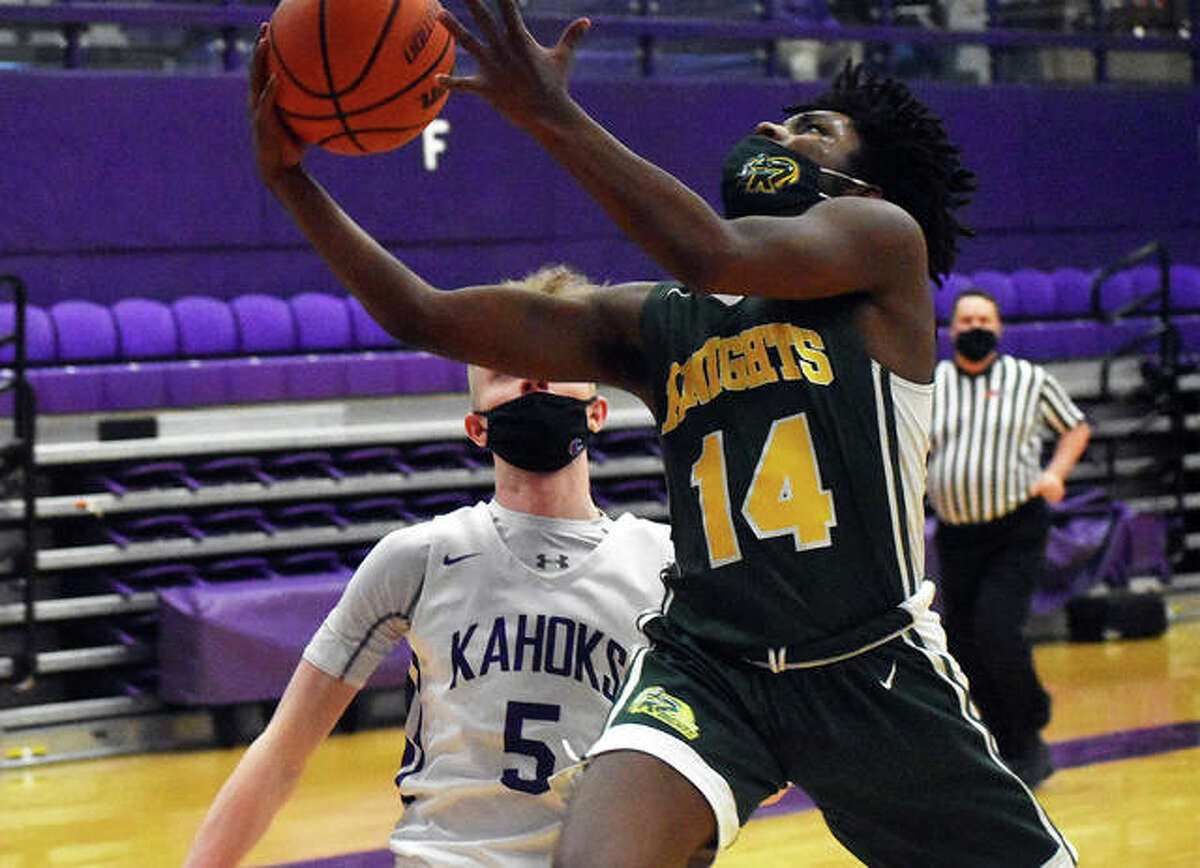 Metro-East Lutheran's Roderick Holmes goes up for a lay-in after a steal during the second quarter of Friday's game against Collinsville inside Vergil Fletcher Gymnasium. Web Gallery for MELHS-Collinsville