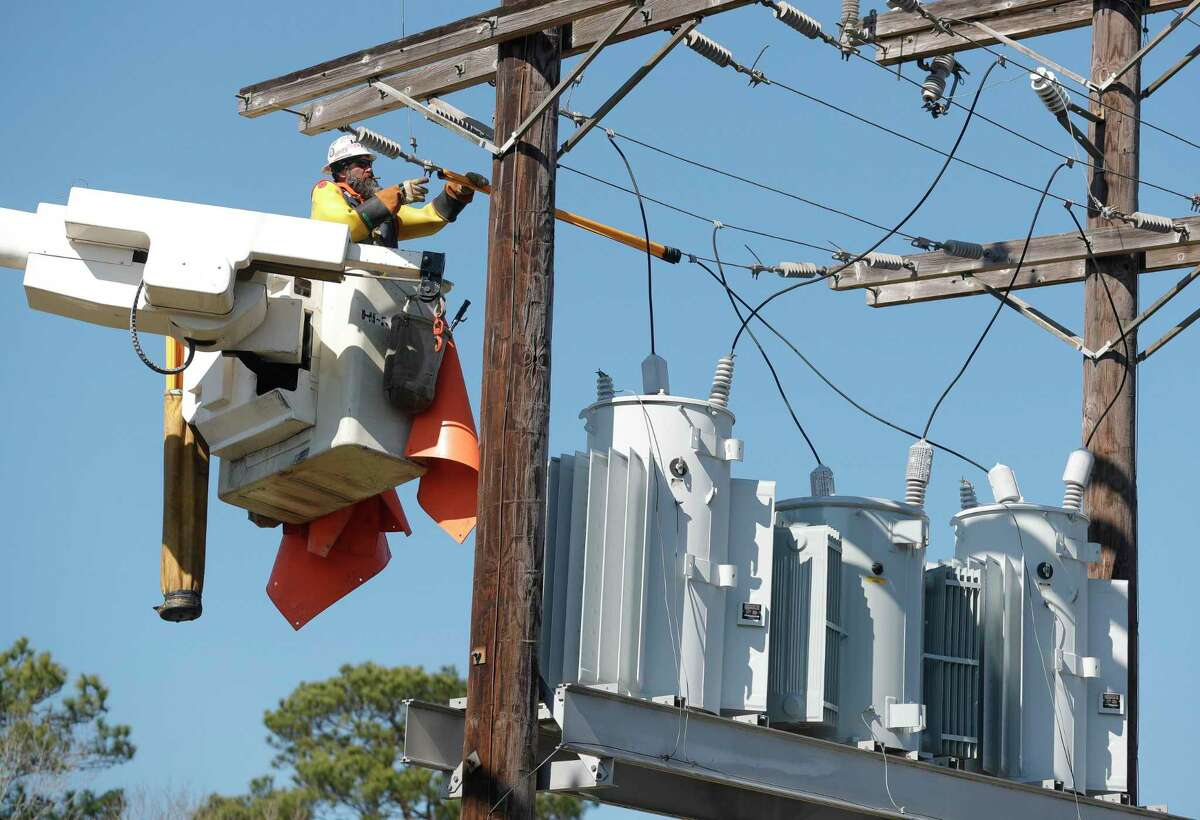 Bright Star Solutions utility line contractors workers on power lines for a nearby subdivision, Friday, Feb. 18, 2021, in Montgomery.
